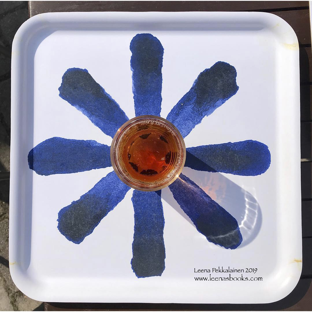 A glass of ice tea in the middle of a flower painted on a tray. www.leenasbooks.com